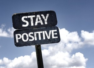 Stay Positive sign with clouds and sky background