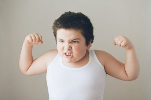 boy with muscles following gym workout